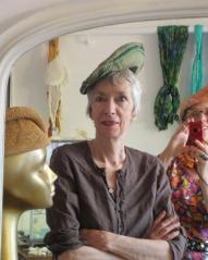 Joanie in a hat